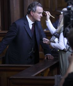 Downton Abbey behind the scenes - Taking the stand: Hugh Bonneville has make-up applied before his court scene defending Mr Bates