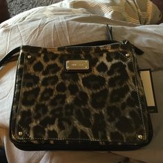 Nine West cross body bag Leopard print Nine West cross body bag. There is a slight scratch on the bag pictured in picture two. Scratch is hardly noticeable Nine West Bags Crossbody Bags