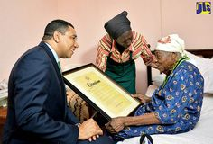 Prime+Minister+Holness+presents+National+Honour+to+World's+Oldest+Living+Person