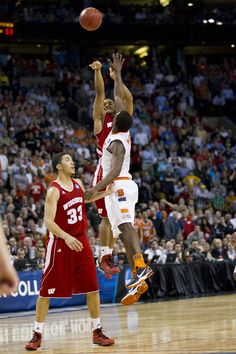 Jordan Taylor elevates, but his final shot comes up just short in the Badgers' Sweet 16 loss to Syracuse (David Stluka).