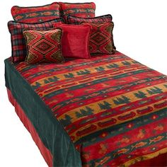 The Denali Fish Lodge Bedspread Blanket handsomely combines rustic imagery, vibrant lodge colors