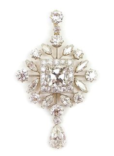 Early 20th century diamond cluster pendant, c.1910,   of lozenge outline, centred by a square cushion diamond cluster panel, to an openwork border of round and marquise cut diamonds, hung with a pear shaped diamond drop, on a graduated two stone diamond suspension loop, claw and millegrain set