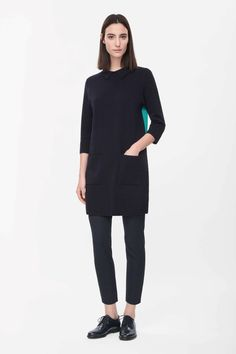 A collared style, this dress is made from milano-knit cotton with a contrast colour panel on the back. A loose, boxy fit, it has patch front pockets, 3/4 sleeves and a hidden zip fastening on the back. COS