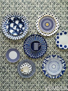 Graphic blue-and-white prints on porcelain plates, mugs and saucers