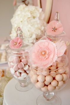 I have always loved the idea of doing a candy bar at parties (I actually did one for a baby shower I threw for my dear friend and it was a huge hit). I love how this person added those dainty little flowers to the jars...makes it super cute.