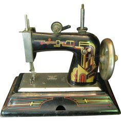 Casige German Toy Sewing Machine with Art Deco Style Designs