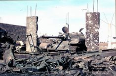 Knocked out Syrian T-55 tank looks into destroyed house, Yom Kippur War.