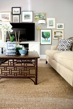 living room with gallery wall and fretwork coffee table