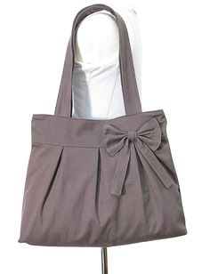 brown cotton fabric purse with bow / tote bag / shoulder bag / hand bag / diaper bag - zipper inside pocket. $26.00, via Etsy.