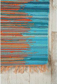 Rag rug from Urban outfitters. Loving the orange and turquoise together.