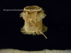 A small jar covered in lace.