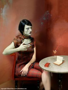 Otto Dix portrait of the journalist Sylvia von Harden by Edland Man, pants and top Prada