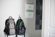 back pack hooks from IKEA (bjarnum) (they fold up when not in use); wall file holder from TJ MAXX