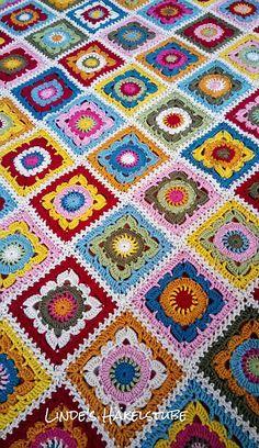 Used yarn: 100 g 1823 Mustard  96 g 1708 Petrol 138 g 1123 Claret  54 g 1023 Rasperry 116 g 1080 Pale Rose 122 g 1722 Storm Blue  62 g 1065 Meadow 120 g 1709 Gold 100 g 1027 Khaki 328 g 1280 Parchm...
