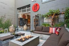 Make sure to consider heating for any outdoor space. A modern fire pit is a great option.
