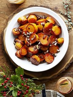 After adding pecans for a little bit of crunch, coat this Thanksgiving favorite in a sorghum-glaze.  Get the recipe at Country Living »    - HouseBeautiful.com Holiday Dinner, Christmas Holiday, Christmas Side Dishes, Simple Christmas, Spiced Pecans, Candied Pecans, Baking Dishes, Food Dishes, Glazed Sweet Potatoes