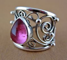 Pink tourmaline and sterling silver filigree ring size 7 OOAK. $195.00, via Etsy.