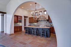 Traditional Kitchen with terracotta tile floors, mexican tile backsplash, Flush, Breakfast bar, Farmhouse sink, High ceiling
