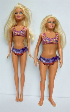 Artist Nickolay Lamm created a Barbie shaped more like an average woman - (pictured at right next to a standard Barbie)