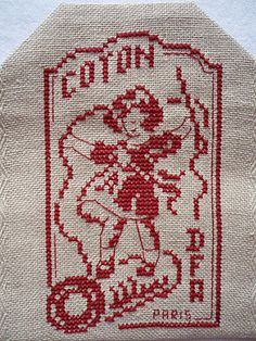 pretty cross stitch embroidery, needle and thread