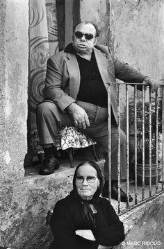Naples, 1976. A mafioso with his mother observes the life of the street.  [Credit : Marc Riboud]