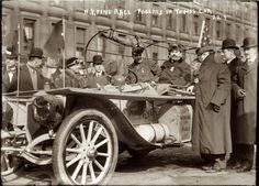 February 12, 1908 - Montague Roberts in Times Square driving the Thomas Flyer at the start of the New York to Paris automobile race. Six cars representing four nations (Germany, France, Italy and the United States) were at the starting line for what would