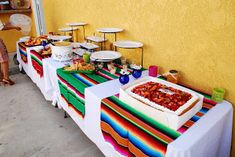 I like the serapes over the white cloth (MKR Creations: Mexican Fiesta Bridal Shower) (fiesta party decorations mexican) Mexican Party Favors, Mexican Fiesta Party, Fiesta Theme Party, Taco Party, Party Themes, Party Ideas, Mexican Fiesta Decorations, Fiesta Cake, Theme Parties