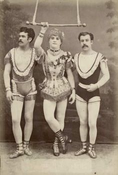 3 High flying circus acrobats pose for a picture in costume in Germany in 1884. One is dressed as a woman and would pretend to be one during the performance showing surprising strength.
