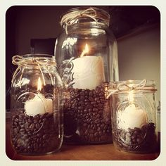 Mason jar candle set - So easy to make! Just buy different sized mason jars, fil. Mason jar candle set - So easy to make! Just buy different sized mason jars, fill with coffee beans and vanilla pillar c. Mason Jar Candles, Candle Set, Mason Jar Crafts, Pillar Candles, Coffee Candle, Mason Jar Kitchen Decor, Coffee Theme Kitchen, Cafe Themed Kitchen, Creation Deco