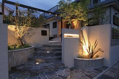 Spectacular garden lighting by lighting professionals. Enjoy a dramatic, romantic, even mysterious scene comparing to a day time. Exterior Front Doors, House Paint Exterior, Exterior Paint Colors, Exterior House Colors, Exterior Design, Interior And Exterior, Ranch Exterior, Exterior Remodel, Compound Wall Design