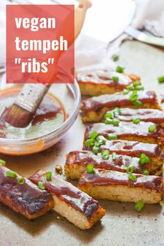 Smoky, savory, and slathered in sweet and zippy homemade barbecue sauce, these vegan ribs are made from tempeh! Cook them in the oven or on the grill for a meatless summer feast! Entree Vegan, Vegetarian Main Dishes, Vegan Dinner Recipes, Delicious Vegan Recipes, Vegan Dinners, Vegetarian Recipes, Vegan Appetizers, Tempeh, Tofu