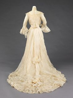 Wedding Dress  Madame Herzfelder  Date: 1902 Culture: American Medium: silk.  Credit Line: Brooklyn Museum Costume Collection at The Metropolitan Museum of Art, Gift of the Brooklyn Museum, 2009; Gift of Madeleine B. Stern, 1958.  I LOVE LOVE LOVE this wedding dress, it is SO beautiful, AND the train is to die for.  I would kill to cuddle with this, it is undoubtedly REALLY soft!!!