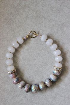 This is one of four of my newest spring stone bracelets. I accented the strand with gold Indian glass beads, and a delicate but strong14k