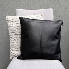 Decorative black leather 16 square pillow cover, made of buttery soft upcycled leather. In its previous life, the leather used to be a coat. It has