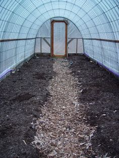 The interior of a basic hoop house design using inexpensive fence panels