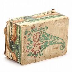 circa 1800, the box naively constructed of paper and board and with watercolor decoration in green and brown, box lid features an embroidered pin cushion and needle case of wool and paper, interior with early wallpaper lining. Box was likely made by Sara Mitchell (b. about 1818). The 1880 US Federal Census shows Sarah living in Forbush, Yadkin, North Carolina in the household of Isaac A. Jarratt and Ellin Jarratt.2.5 x 6 x 4.25 in.Acquired from the Estate of Dunreath Jarratt Edwards of…