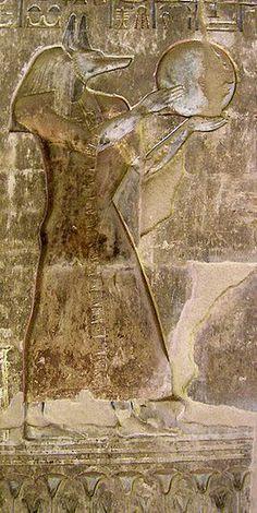 Anubis holding the Lunar disk