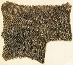 European riveted mail gusset / voider, with brass makers mark, 15th to 16th century, Philadelphia Museum of Art. I5.