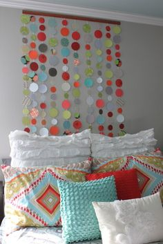 For Caleighs room...paper wall art cheap & makes the perfect headboard for a girls room