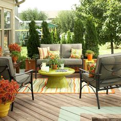 love the idea of painting a fun color on the deck and the layout of furniture.    its not just dining tables anymore for your outside living spaces. COUCHES, COUCHES, COUCHES!