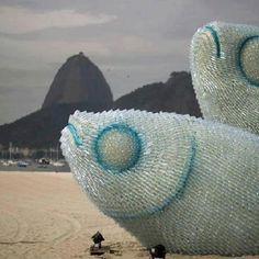Enormous fish sculpture made from littered plastic water bottles on the beach in Rio.