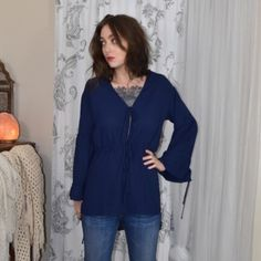 Bohemian Blue Tunic Top Ties in front. Bell sleeves. Size small / medium. My measurements are 34 C bust, 5'8 height and size 4/27 bottoms size. Ocean blue color. Same day shipping on all orders. No trades but offers are welcome. linjia Tops Tunics