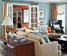 Cozy Living Room by delia.  Like the rusty colors with the blues and the chocolates.  G