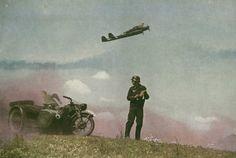 A Focke Wulf Fw 189 flies over Kradschutzen (MC troops) on the Ostfront