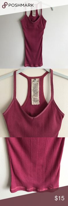 Abercrombie & Fitch pink ribbed racerback tank Abercrombie & Fitch pink ribbed fitted racerback tank w/metallic stitching, built in bra - perfect condition never worn Abercrombie & Fitch Tops Tank Tops