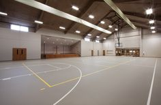Helmar Lutheran Church in Helmar, IL. Features of this multi-purpose room: Gym, Gathering Hall, Geothermal, Basketball hoops, Stage, pre-fabricated metal building, volleyball court.
