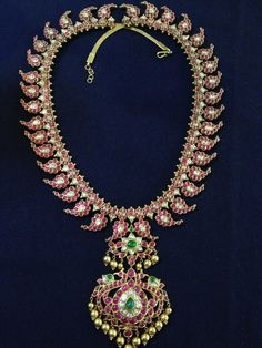 Indian Jewellery and Clothing: Rubies and emerald studded magayamala excellently carved with peacocks from Nathella jewellers..