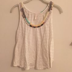 Free people beaded tank top - Cute fp tank top. Beaded in a variety of ilirs and the back has a slit and folds over Free People Tops Tank Tops
