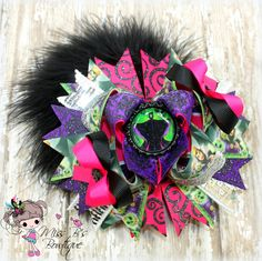 #maleficent  #hairbow #hairaccessories #stackedboutiquebow #overthetopboutiquebow #missbsbowtique  Follow our facebook page for weekly auctions and more! www.facebook.com/missbsbowtique05  Place a custom order today over on our Etsy shop!  www.etsy.com/shop/missbsbowtique05