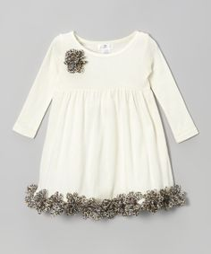 Featuring a wild, ruffled rose embellishment on the bodice and matching petal-filled trim on the skirt, this pretty dress is fanciful and free. The soft feel and pullover design allow bitty blossoms to twirl to their heart's content.100% cotton exclusive of decorationHand wash; dry flatImported